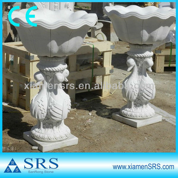 Stone flying eagle sculptures