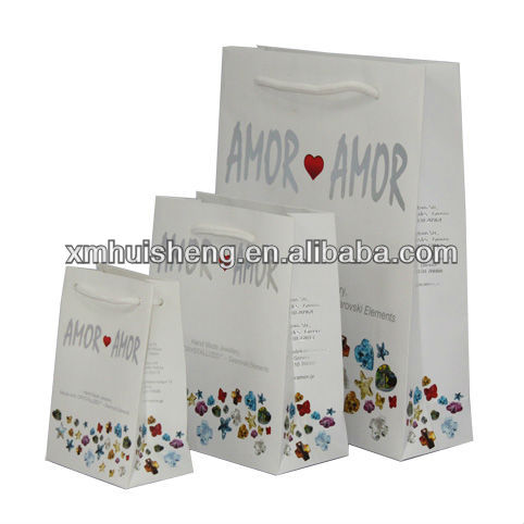 Custom made OEM hot stamping paper shopping bag with pp handle
