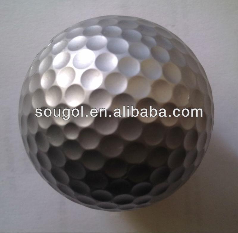 golden colored golf balls