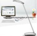 Lámpara de escritorio de brazo abatible