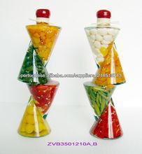 Frutas decorativas em frasco de vidro