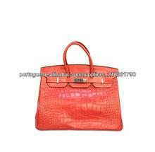 designer de bolsas de couro
