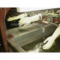 No- detener el funcionamiento de máquinas para hacer los guantes de látex