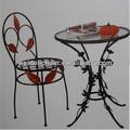de hierro forjado jardín mesa y una silla conjuntos