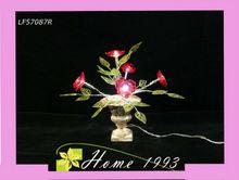 lámpara de luz fluorescente cubierta con la flor