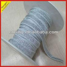 Metallic elastic webbing shoulder straps
