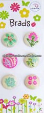 Designed pattern fabric embroidery brads and buttons