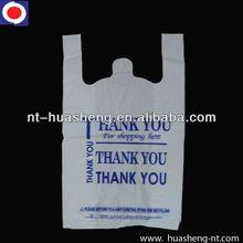 white printed plastic shopping bags