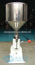 Table model manual liquid/lotion/cream filling machine