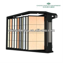 Butterfly flip tile display rack