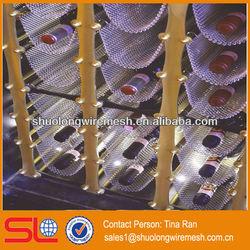 Cascade coil's woven wire fabric drapery