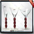 clear wine glass with red colored twist stem
