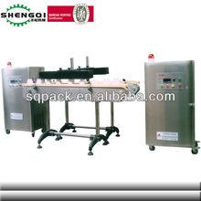 The Plastic lid Induction aluminum foil sealing machine shanghai