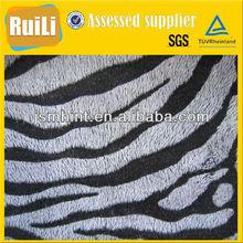 tip-discharging short pile fleece fabric