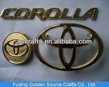 golden toyota corolla chromed plastic car logo badge