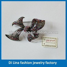 Metal novelty feather flower brooch pin