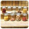 different shapes of storage glass jars, food jars