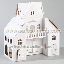 White cardboard play house for kid drawing