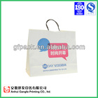 Customized cheap small paper gift bags with handles