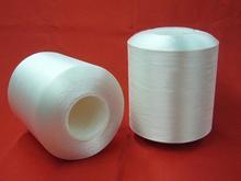 sewing yarn round white sofa