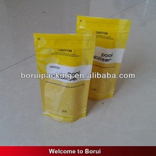 Yellow plastic bag for puppy chews with bottom gusset