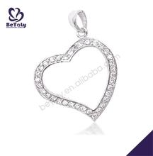 Generous sterling silver gem-studded heart female agate slice pendants