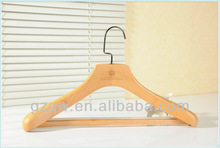 Contoured environmental wooden suit hanger with bar