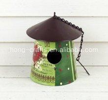 Metal bird feeder with flower pot