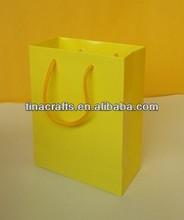 Yellow shopping paper bag