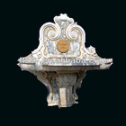 Colorful carved stone sink and basin