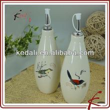 round cruets oil and vinegar with bird design