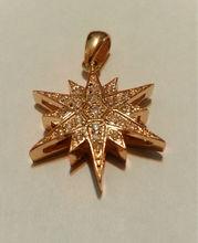 14k gold star of betlehem pendant with 0.25ct of diamonds