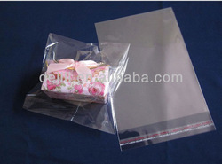 Gift packing bags with selfadhesive lip