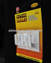 White plastic heavy duty adhesive hooks