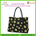 negro y oro de la flor de lis de impresión de algodón acolchado de bolsos de mano