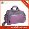 Purple gymnastics duffel bag with two side pocket