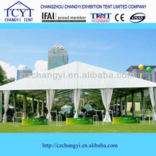 Large outdoor party tent with colorful ceiling drape