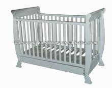 white wooden baby crib
