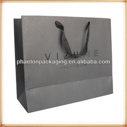 qingdao custom white kraft paper bag with printing logo and light green nylon handle