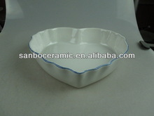 white ceramic bakeware with heart shape