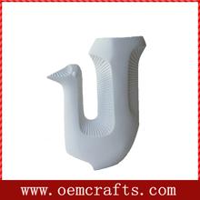 nuevo pájaro de cerámica florero