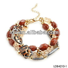 Coral beads and leopard acrylic multi elements and fashion bracelet