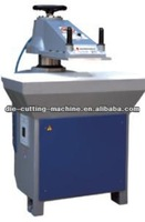 Hydraulic swing arm tannery cutting machine