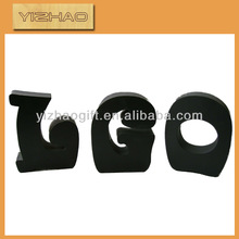 Free standing wooden word decoration on base