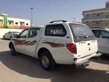 Mitsubishi L200 D/cab 4x2 Petrol with Canopy