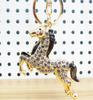 Looping horse manmade diamond crystal rhinestone gold keychain