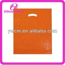 China Yiwu orange pe handle shopping bags with punch hole