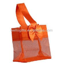 orange organza shopping bag with bow decoration