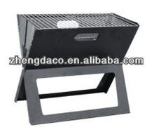 large black shiny X shape barbecue grill/outdoor kitchen
