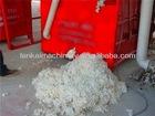Vertical cotton boll sheller